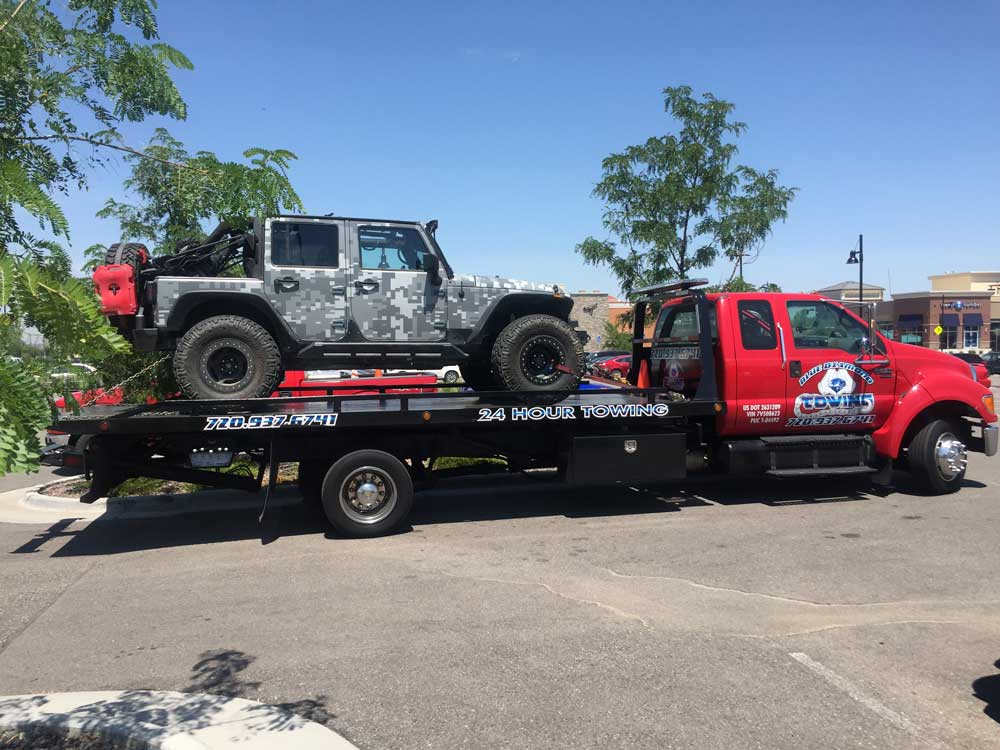 jeep on flat bed truck